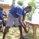 The Water Project: Mwikhupo Primary School -  Handwashing With Leaky Tin