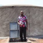 The Water Project: Mwikhupo Primary School -  Mr Nabangi At The Rain Tank