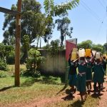 The Water Project: Itieng'ere Primary School -  Students Arrive At School Carrying Water