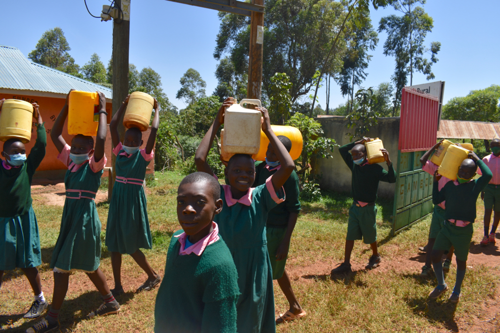 The Water Project : kenya21243-students-carrying-water-3