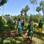 The Water Project: Itieng'ere Primary School -  Students Carrying Water To School