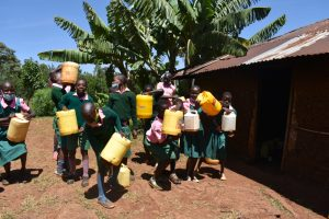 The Water Project:  Students Unloading Their Water At School