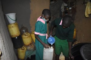 The Water Project:  Children Collecting Water From A Nearby Home