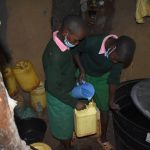 The Water Project: Itieng'ere Primary School -  Collecting Water From A Nearby Home