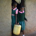 The Water Project: Itieng'ere Primary School -  Students Leaving Home With Water