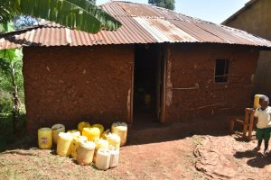 The Water Project:  Water Containers Outside The Kitchen