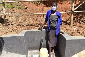 The Water Project:  Doreen Akhaoya Shisia Masked Up