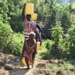 The Water Project: Maraba Community, Shisia Spring -  Water From Shisia Spring En Route To Use
