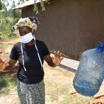 The Water Project: Maraba Community, Shisia Spring -  Demonstrating Air Drying Afer Handwashing