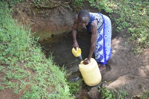 The Water Project:  Repha Collecting Water