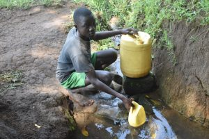 The Water Project:  Tyrone Collecting Water