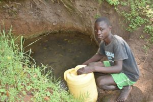 The Water Project:  Tyrone Fetching Water