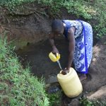 The Water Project: Emusaka Community, Manasses Spring -  Water Users Collecting Water