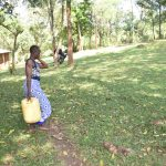 The Water Project: Emusaka Community, Manasses Spring -  Carrying Water