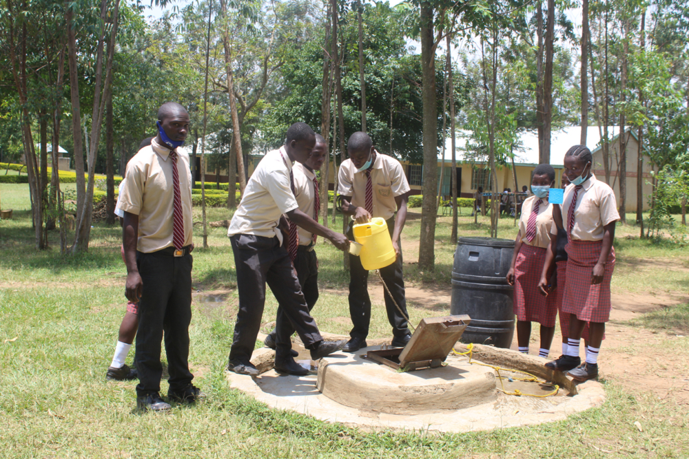The Water Project : kenya21359-getting-a-drink-from-the-well-2