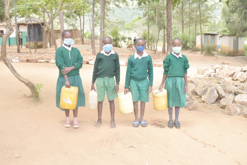 The Water Project : kenya21469-students-with-water-containers