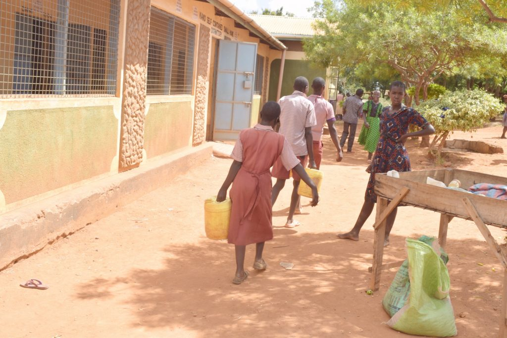 The Water Project : kenya21471-students-carrying-water-2