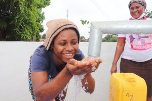 The Water Project:  Young Girl Celebrates At The Well