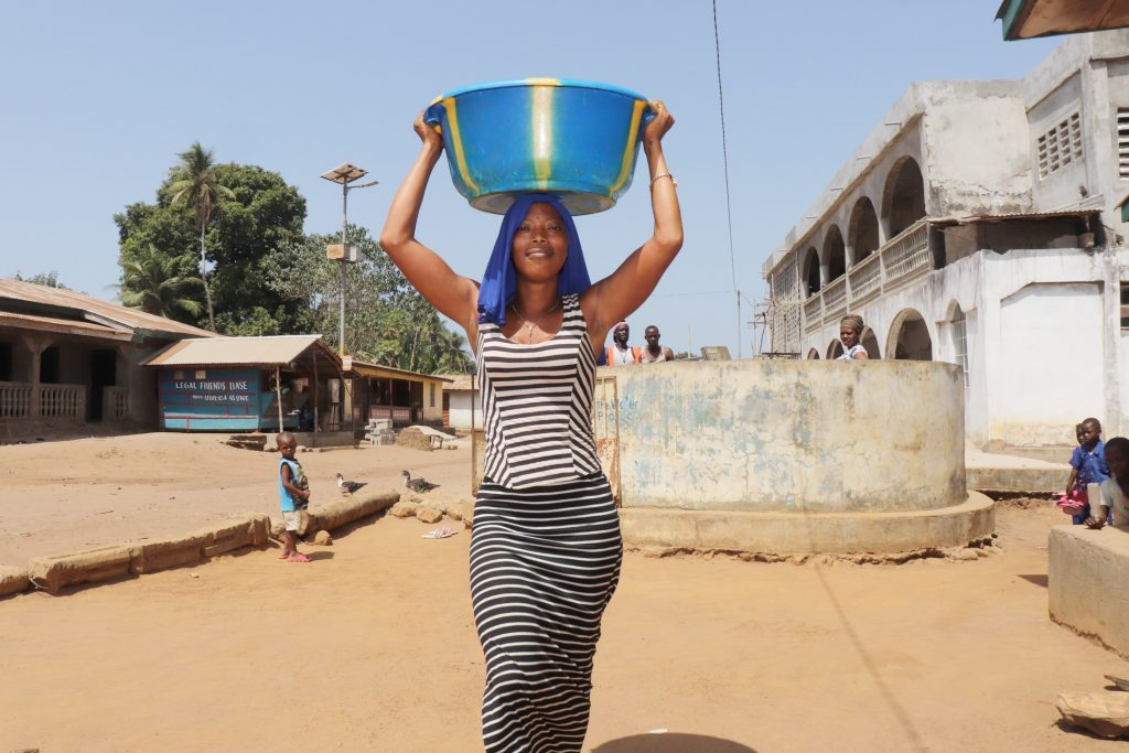 The Water Project : sierraleone21511-woman-carrying-water-1-2