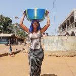 The Water Project: Lungi, Yongoroo, #7 Kamara Taylor Street -  Woman Carrying Water