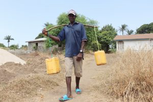 The Water Project:  Young Man Selling Palm Wine