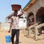 The Water Project: Lungi, Yongoroo, #7 Kamara Taylor Street -  Young Man Carrying Water
