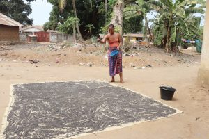 The Water Project:  Woman Processing Black Sand