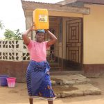 The Water Project: Masoila Gateway Baptist Church and Primary School -  Community Member Carrying Water