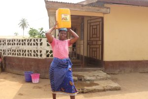 The Water Project:  Community Member Carrying Water