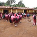 The Water Project: Munamakarr Secondary School -  Students Outside Classroom