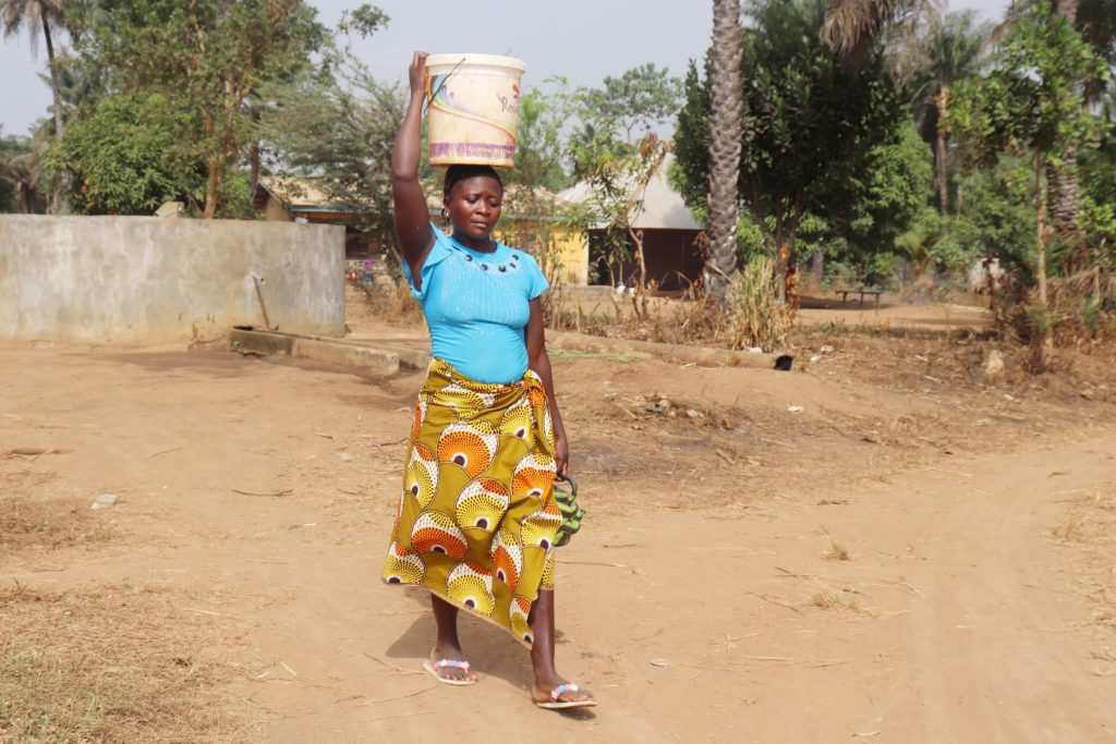 The Water Project : sierraleone21529-young-woman-carrying-water-4