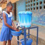 The Water Project: Masoila Gateway Baptist Church and Primary School -  Student Demonstrating Handwashing