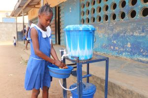 The Water Project:  Student Demonstrating Handwashing