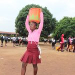 The Water Project: Munamakarr Secondary School -  Student Carrying Water