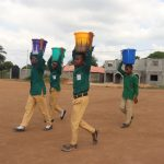 The Water Project: Kulafai Rashideen Primary School -  Students Carrying Water