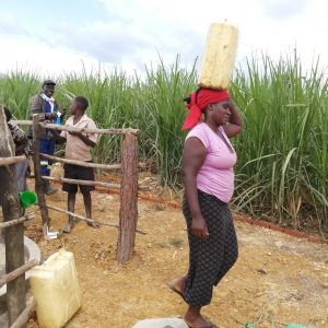 The Water Project:  Carrying Water From The New Well