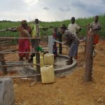 The Water Project: Rubona Kyawendera Community -  Community Members Use Their Well