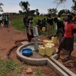 The Water Project: Ejinga Taosati Community -  Fetching Water At Rehabilitated Well