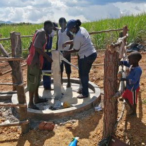 The Water Project:  Finishing Pump Installation