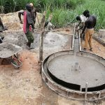 The Water Project: Rubona Kyawendera Community -  Pouring The Cement For The Well Pad