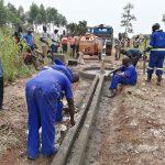 The Water Project: Ejinga Taosati Community -  Working On Well Pad Cement