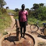 The Water Project: Byerima Community -  Jimmy Birengeso At The Well