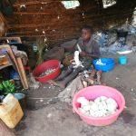 The Water Project: Byerima Kyakabasarah Community -  Child Preparing Food
