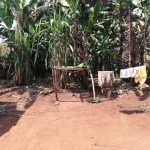 The Water Project: Byerima Kyakabasarah Community -  Clothesline Next To Dishrack