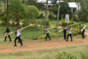 The Water Project:  Students Help Carry Timber For Construction
