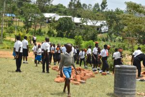 The Water Project:  Students Help Deliver Materials For Construction