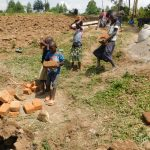 The Water Project: Mukoko Community, Zebedayo Mutsotsi Spring -  Children Ferrying Local Materials To Construction Site