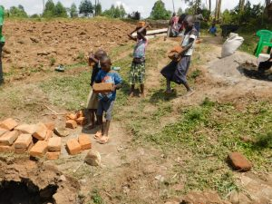 The Water Project:  Children Ferrying Local Materials To Construction Site