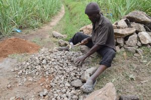The Water Project:  Community Member Making Gravel