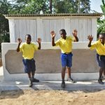 The Water Project: Jimarani Primary School -  Boys Posing At Their New Latrines